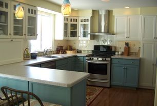 Craftsman Kitchen with single dishwasher, gas range, mexican tile backsplash, Flat panel cabinets, U-shaped, Wall Hood