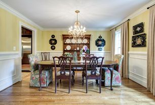 Traditional Dining Room with Standard height, specialty window, Chandelier, Wainscotting, Chair rail, Hardwood floors