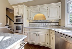 Country Kitchen with L-shaped, Quartz counters, Stone Tile, Raised panel, Chair rail, Granite countertop, Complex Marble Tile