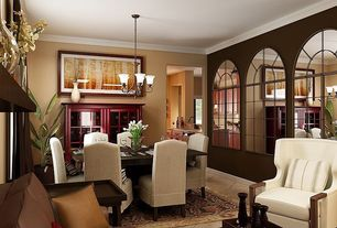 Traditional Dining Room with Chandelier, sandstone floors, Crown molding