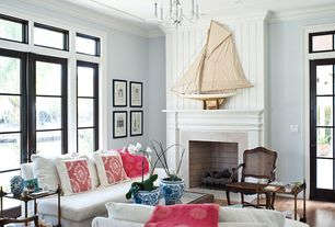 Living Room with Cement fireplace, Transom window, French doors, Chandelier, Hardwood floors, Axis II Slipcovered Sofa