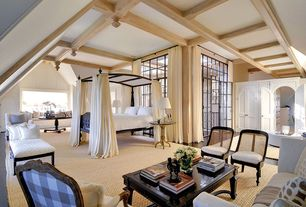 Traditional Master Bedroom with Canopy bed, Laminate floors, specialty door, Bermuda canopy bed, French doors, Transom window
