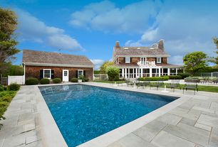 Contemporary Swimming Pool with Pathway, exterior stone floors, Fence, Glass panel door, Raised beds, Gate