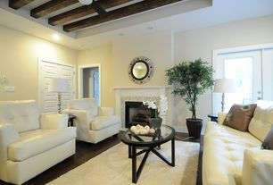 Contemporary Living Room with Exposed beam, French doors, Hardwood floors, Cement fireplace