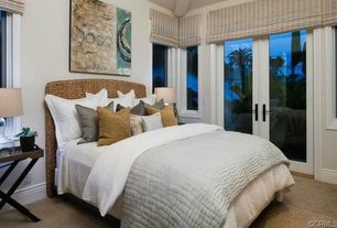 Contemporary Master Bedroom with Home Styles Cabana Banana Queen Panel Bed, Clear glass table lamp, Natural woven roman shade