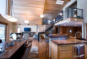 Contemporary Great Room with High ceiling, French doors, Skylight, flush light, Hardwood floors, Columns, Pendant light, Loft