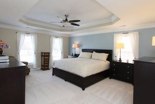 Traditional Master Bedroom with double-hung window, Crown molding, Standard height, Carpet, Ceiling fan