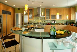 Contemporary Kitchen with Pendant light, Undermount sink, Glass panel, U-shaped, Glass counters, Soapstone counters, Flush