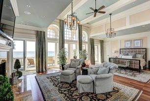 Traditional Master Bedroom with Ceiling fan, French doors, Arched window, Box ceiling, specialty door, stone fireplace