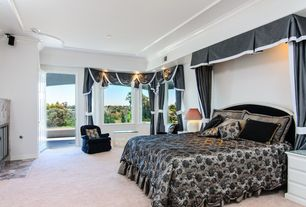 Traditional Master Bedroom with stone fireplace, metal fireplace, Carpet, Crown molding