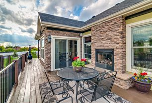 Traditional Deck with sliding glass door, outdoor pizza oven, Fence, double-hung window, Deck Railing