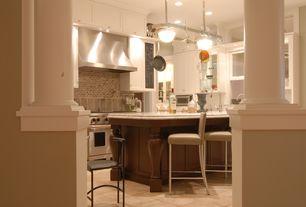 Traditional Kitchen with Columns, Pendant light, U-shaped, Subway Tile, limestone tile floors, Breakfast bar, Undermount sink
