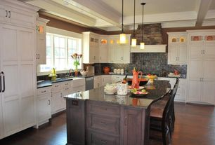 Country Kitchen with full backsplash, can lights, Inset cabinets, Stone Tile, Complex granite counters, Slate Tile, Casement