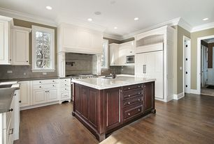 Traditional Kitchen with Stone Tile, Hardwood floors, Kitchen island, Undermount sink, Flush, gas range, Crown molding