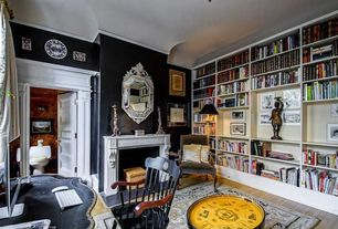 Traditional Home Office with Hardwood floors, specialty door, Cement fireplace, Crown molding, Built-in bookshelf