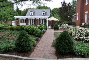 Traditional Landscape/Yard with Fence, exterior brick floors, Casement, Transom window, French doors, Pathway, Trellis