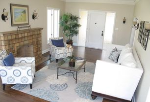 Traditional Living Room with Crown molding, Wall sconce, Hardwood floors, stone fireplace