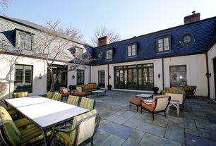 Traditional Patio with exterior tile floors, French doors