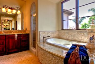 Mediterranean Master Bathroom with Master bathroom, Flat panel cabinets, Simple marble counters, frameless showerdoor