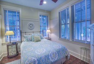 Cottage Guest Bedroom with Ceiling fan, Hardwood floors