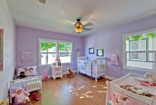 Traditional Kids Bedroom with no bedroom feature, double-hung window, Laminate floors, Standard height, Ceiling fan