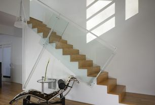 Modern Staircase with High ceiling, Hardwood floors, Floating staircase