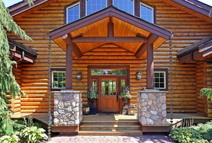 Rustic Entryway with Standard height, Columns, Glass panel door, picture window, Paint, Transom window, Wall sconce