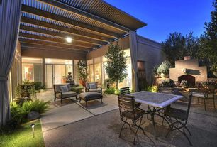 Traditional Patio with picture window, sliding glass door, Fountain, Trellis, exterior tile floors, Raised beds