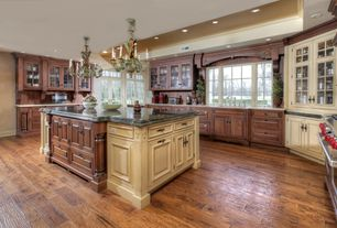Traditional Kitchen with Soapstone counters, Flat panel cabinets, Standard height, Transom window, Raised panel, Glass panel