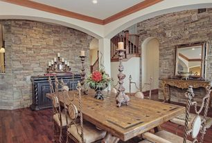 Rustic Dining Room with Hardwood floors, Columns, Crown molding