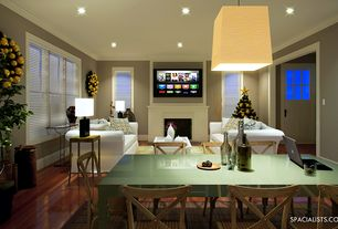 Contemporary Great Room with double-hung window, Crown molding, Pendant light, can lights, Standard height, Fireplace