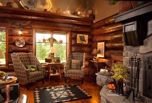 Rustic Living Room with Wall sconce, stone fireplace, High ceiling, Hardwood floors