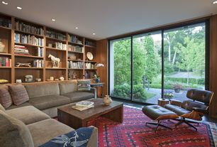 Contemporary Library with Built-in bookshelf, Concrete floors