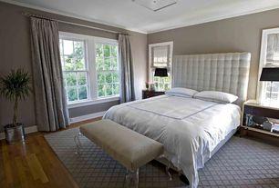 Contemporary Master Bedroom with Built-in bookshelf, Hardwood floors, flush light, Tech Lighting Chambers Flush Mount