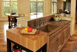 Country Kitchen with L-shaped, Copper counters, Kitchen island, Travertine counters, Undermount sink, Flat panel cabinets