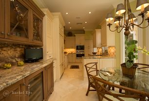 Traditional Kitchen with Breakfast nook, Complex Granite, Undermount sink, Flat panel cabinets, U-shaped, double wall oven