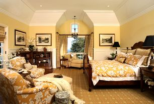 Traditional Master Bedroom with picture window, Crown molding, Chandelier, Built-in bookshelf, can lights, French doors