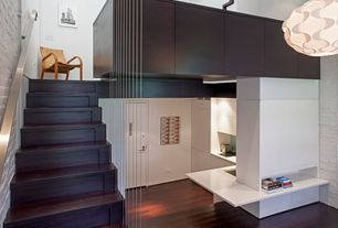 Modern Staircase with interior brick, Floating staircase, High ceiling, Hardwood floors