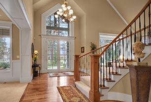 Traditional Entryway with Crown molding, Hardwood floors, High ceiling, French doors, Chandelier