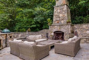 Traditional Patio with Outdoor kitchen, exterior stone floors, Fence, Pathway
