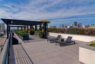 Contemporary Deck with exterior tile floors, exterior concrete tile floors, Raised beds, picture window, Deck Railing