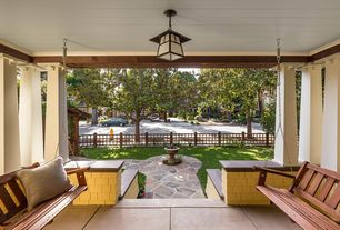 Craftsman Porch with Fence, Pathway, Bird bath, Trellis, exterior tile floors, Porch swing