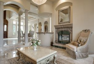 Traditional Living Room with High ceiling, stone fireplace, Cement fireplace, Crown molding, Columns, Sunken living room