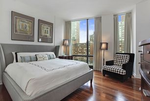 Contemporary Master Bedroom with Hardwood floors, picture window, Standard height