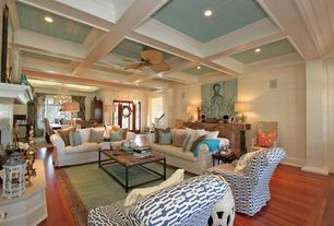 Traditional Living Room with Hardwood floors, Crown molding, Cement fireplace, Ceiling fan, Columns, Box ceiling