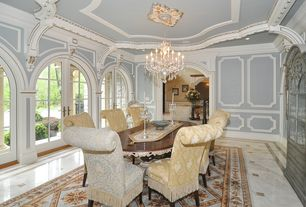 Traditional Dining Room with Chair rail, Arched window, Chandelier, Wainscoting, Crown molding