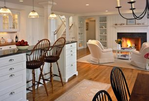 Cottage Great Room with Pendant light, stone fireplace, Windsor Bow Back Arm Swivel Bar Stool, Built-in bookshelf, Columns