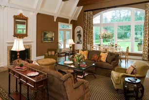 Traditional Great Room with Exposed beam, Tufted ottoman, Royal court dining chair, Iron and glass coffee table, Area rug