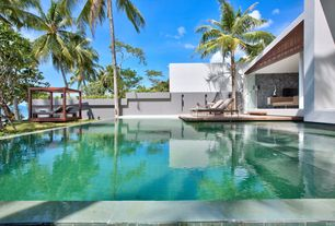Modern Swimming Pool with exterior stone floors, Lounge chair - poolside, Pathway, Gazebo, Infinity pool, Fence
