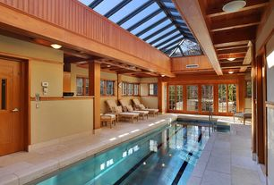 Contemporary Swimming Pool with Skylight, exterior tile floors, Indoor pool, Glass panel door
